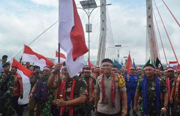 Songsong HUT TNI,di Warnai Taburan Bendera Merah Putih di Ambon